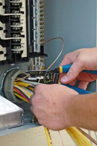 technicians-hands-working-on-wires-in-electrical-panel