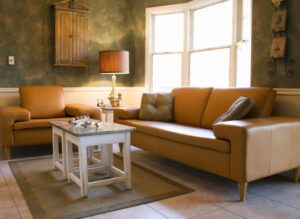 pretty-home-interior-living-room-tan-couch-green-walls